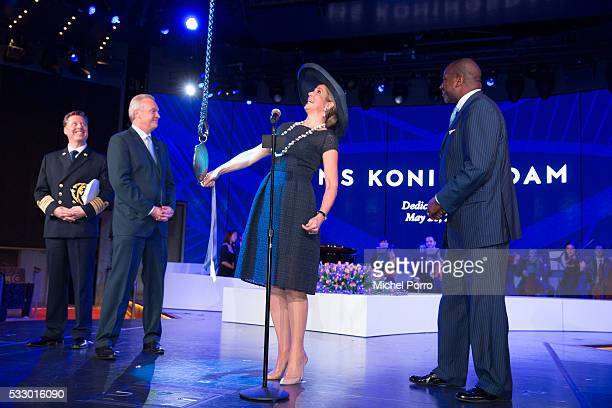 Captain Emiel de Vries Stein Kruse CEO Holland America Group and Orlando Ashford President Holland America Line watch Queen Maxima of The Netherlands...