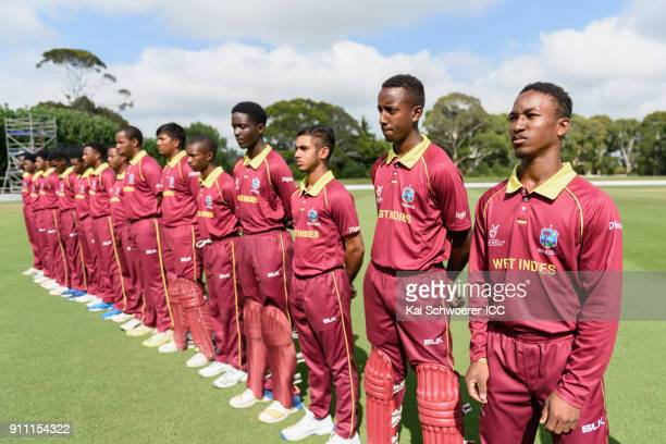 Captain Emmanuel Stewart of the West Indies and his team mates line up for their national anthem prior to the ICC U19 Cricket World Cup Plate Final...