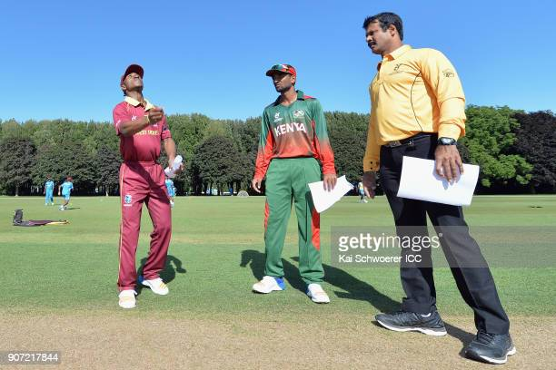 Captain Emmanuel Stewart of the West Indies captain Sachin Bhudia of Kenya and umpire Nandan take part in the coin toss prior to the ICC U19 Cricket...