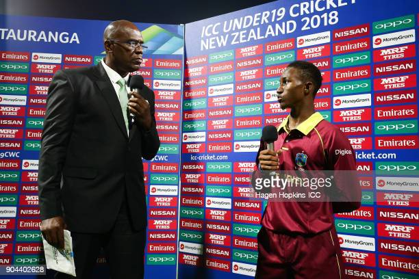 Captain Emmanuel Stewart of the West Indies is interviewed by former West Indies cricketer Ian Bishop during the ICC U19 Cricket World Cup match...