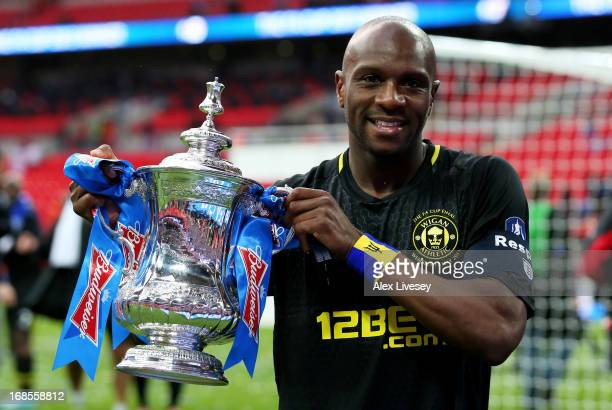 Captain Emmerson Boyce of Wigan Athletic celebrates with the trophy following his team's 10 victory during the FA Cup with Budweiser Final between...