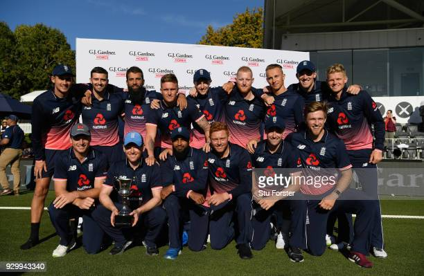 Captain Eoin Morgan and his England team mates celebrate after their 3-2 series victory after the 5th ODI between New Zealand and England at Hagley...