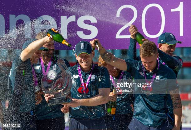 Captain Eoin Morgan holds the Royal London trophy as England celebrate the series win and 50 whitewash over Australia during the 5th Royal London ODI...