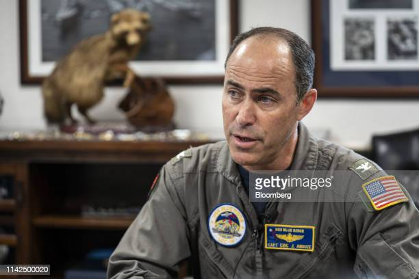 Captain Eric J Anduze commander of the US Navy's USS Blue Ridge speaks to the members of the media not pictured during a media tour of the ship...