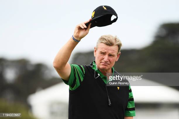 Captain Ernie Els of South Africa and the International team acknowledges the crowd after they were defeated 16-14 during Sunday Singles matches on...