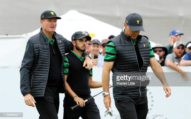 Captain Ernie Els of South Africa and the International team walks with Abraham Ancer of Mexico and the International team and Assistant Captain...