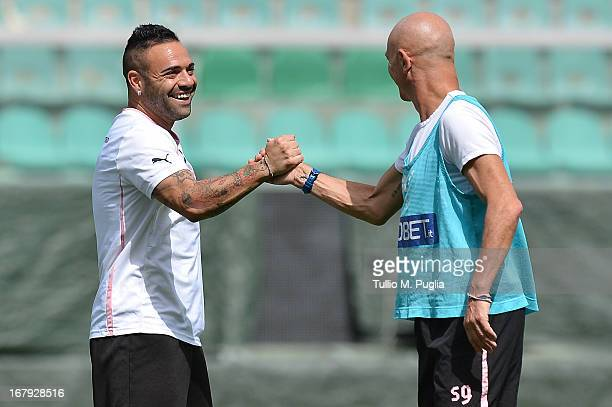 Captain Fabrizio Miccoli and head coach Giuseppe Sannino shake hands during a Palermo training session at Stadio Renzo Barbera on May 2 2013 in...