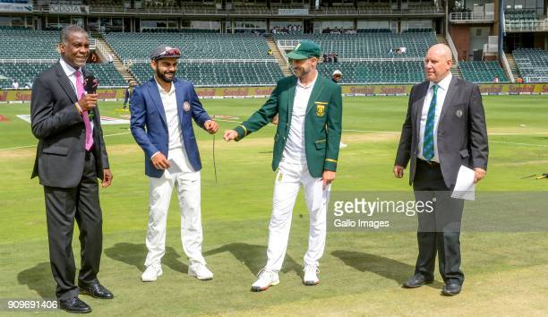 Captain Faf du Plessis of South Africa and captain Virat Kohli of India toss during day 1 of the 3rd Sunfoil Test match between South Africa and...