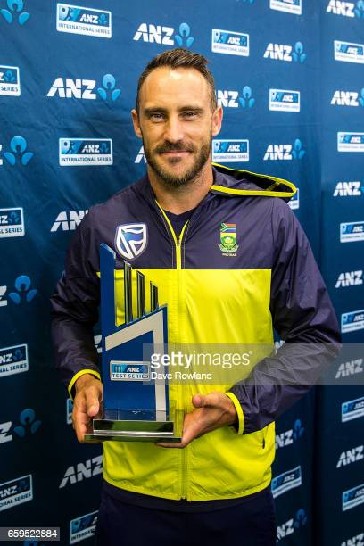 Captain Faf du Plessis of South Africa poses with the series trophy on day five of the Test match between New Zealand and South Africa at Seddon Park...