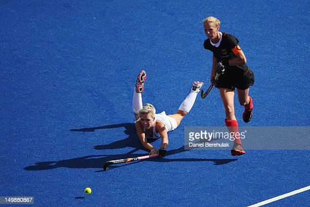 Captain Fanny Rinner of Germany and Charlotte Harrison of New Zealand challenge for the ball during the Women's Hockey match between Germany and New...