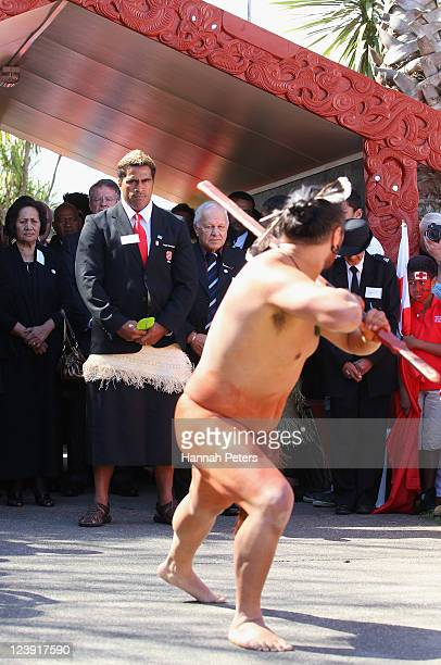Captain Finau Maka of Tonga is challenged by a traditional Maori Warrior during the Tonga IRB Rugby World Cup 2011 official team welcome ceremony at...