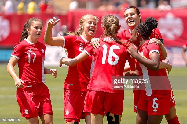 Captain Forward Christine Sinclair of Team Canada and teammates Forward Janine Beckie Forward Deanne Rose Midfielder Rebecca Quinn and Midfielder...