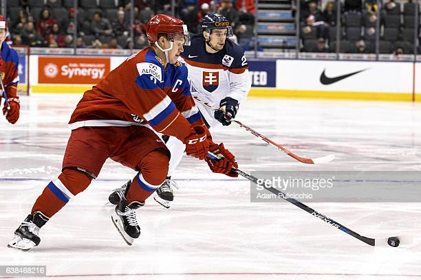 Captain forward Kirill Kaprizov of Team Russia skates by the faceoff circle in the Team Slovakia defensive zone in a preliminary round Group B game...