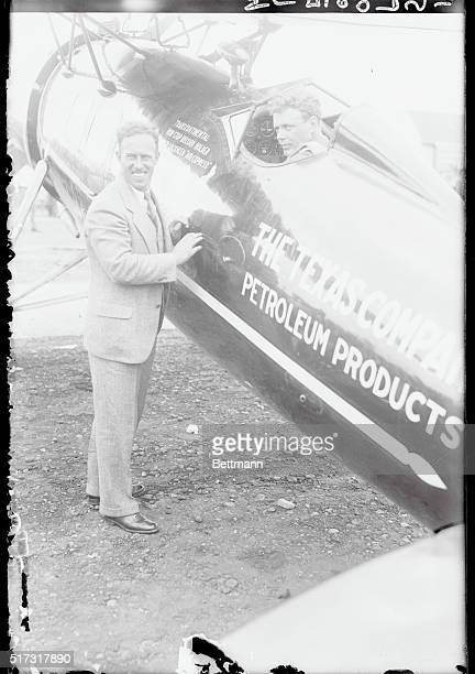 Captain Frank Hawks explaining the workings of his Lockheed Vega Air Express to Colonel Charles A Lindbergh which he loaned to Lindy who flew the...