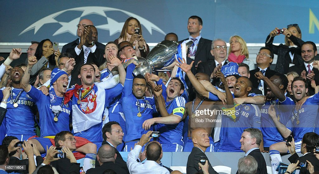 Captain Frank Lampard and Jose Bosingwa of Chelsea lift the trophy in celebration after their victory in the UEFA Champions League Final between FC Bayern Munich and Chelsea at the Fussball Arena Munich on May 19, 2012 in Munich, Germany. The match ended 1-1 after extra time, Chelsea won 4-3 on penalties.