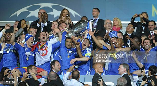 Captain Frank Lampard and Jose Bosingwa of Chelsea lift the trophy in celebration after their victory in the UEFA Champions League Final between FC...