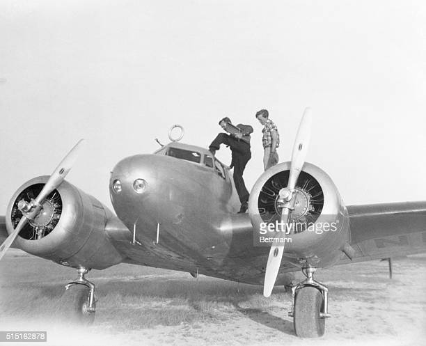 Captain Fred Noonan and pilot Amelia Earhart enter their Lockheed Electra 10E in San Juan Puerto Rico during Earhart's aroundtheworld flight attempt...
