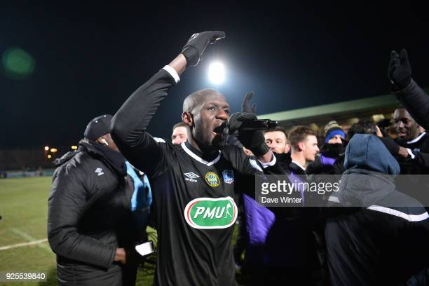 Captain Gaharo Mady Doucoure of Chambly leads the celebrations after his side wins the French Cup match between Chambly and Strasbourg at Stade...