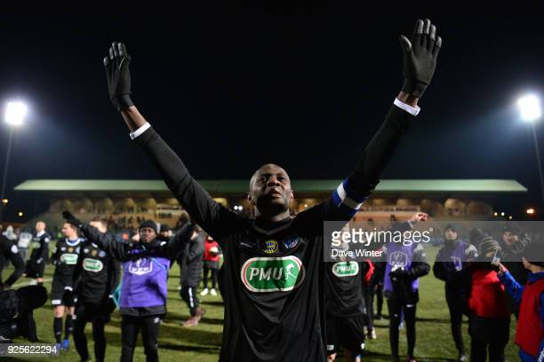 Captain Gaharo Mady Doucoure of Chambly leads the celebrations after his side win the French Cup match between Chambly and Strasbourg at Stade Pierre...