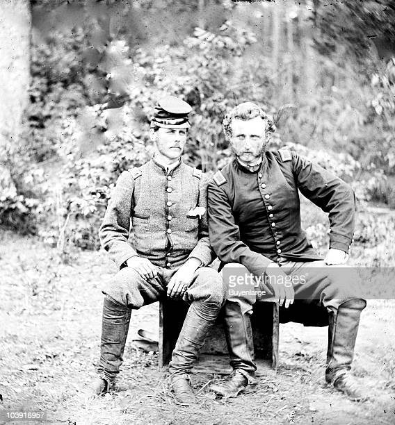 Captain George Armstrong Custer of the 5th Cavalry sits with a Confederate prisoner Lieutenant James B Washington in Fair Oaks VA 1862