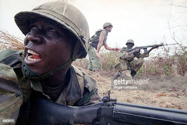 Captain Ghislain St Pierre of the Canadian military instructs Sierra Leone Army trainees in a 'deliberate attack' exercise in a live fire training...