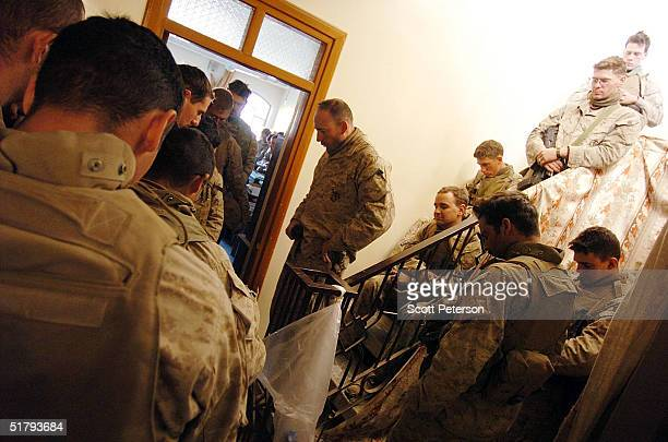 Captain Gil Juarez leads his company in a prayer as US Marines of the 1st Light Armored Reconnaissance company as part of 1st Battalion 3rd Marines...