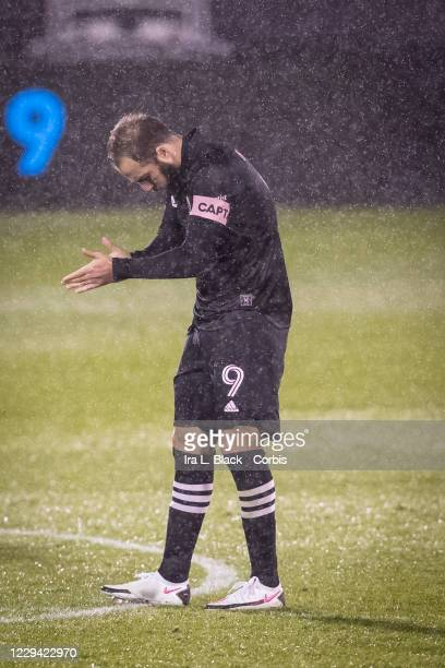 Captain Gonzalo Higuain of Inter Miami CF claps in the rain at the start of the second half of the Major League Soccer match against Toronto FC in...