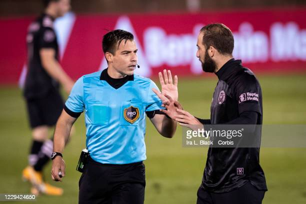 Captain Gonzalo Higuain of Inter Miami CF has a discussion with the referee about a missed call in the second half of the Major League Soccer match...