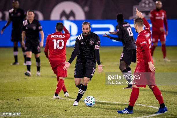 Captain Gonzalo Higuain of Inter Miami CF has his arms outstretched to question the missed call in the second half of the Major League Soccer match...