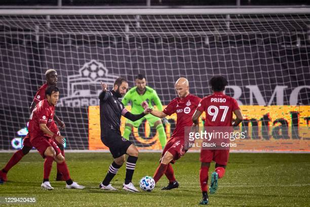Captain Gonzalo Higuain of Inter Miami CF maneuvers in front of the goal against Michael Bradley of Toronto FC in the first half of the Major League...
