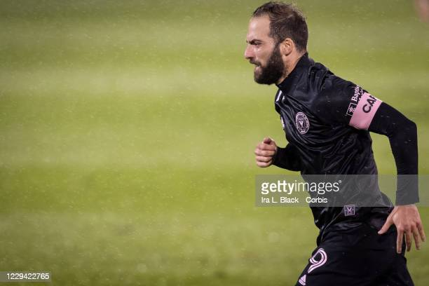 Captain Gonzalo Higuain of Inter Miami CF runs in across the pitch in the rain in the second half of the Major League Soccer match against Toronto FC...