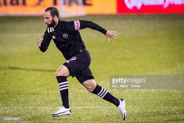 Captain Gonzalo Higuain of Inter Miami CF runs onto the pitch at the start of the Major League Soccer match against Toronto FC in Pratt & Whitney...