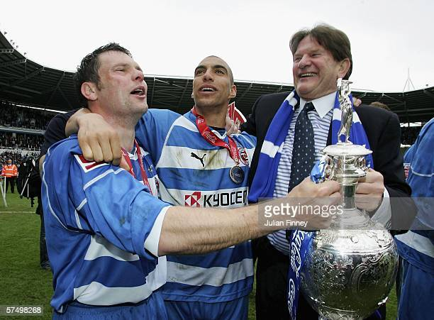Captain Graeme Murty James Harper and John Madejski chairman of Reading celebrate winning the Championship League with the trophy with a record...