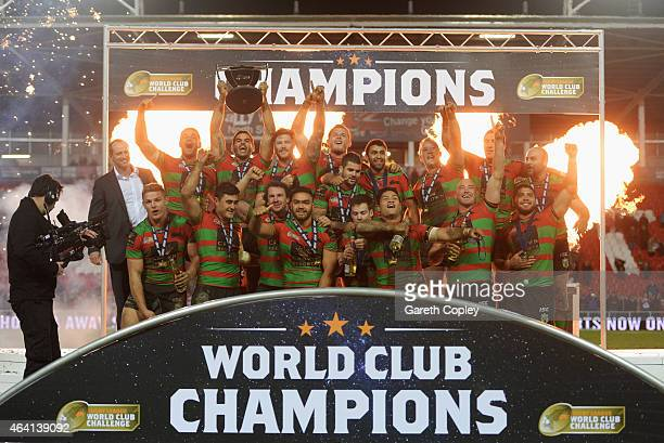 Captain Greg Inglis of South Sydney Rabbitohs lifts trophy in celebration alongside team mates after the World Club Challenge match between St Helens...