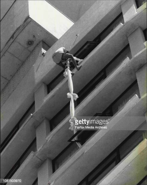 Captain Greg Melick climbs down from the window of the 14th floor during the raid today dressed in a pair of PyjamasCommandos from the 1st company at...