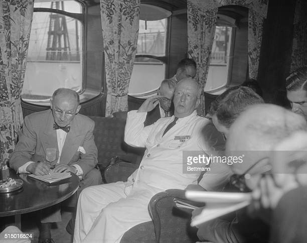 Captain Gunnar Nordenson of the Swedish American liner Stockholm is shown during press interview in New York as he explained the circumstances...