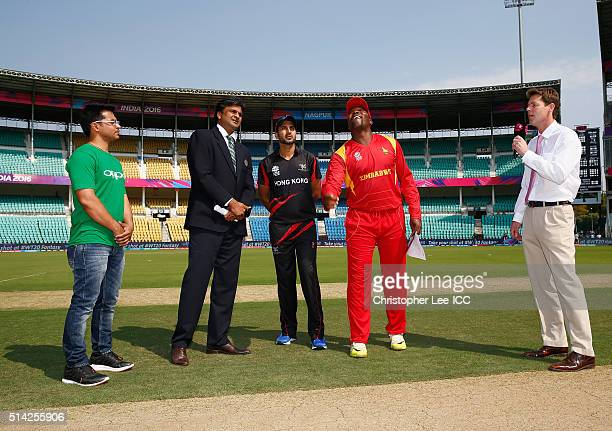 Captain Hamilton Masakadza of Zimbabwe tosses the coin with Captain Tanwir Afzal of Hong Kong during the ICC Twenty20 World Cup Group B match between...