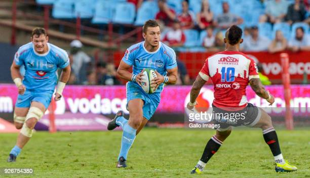 Captain Handre Pollard of the Bulls challenged by Elton Jantjies of the Lions during the Super Rugby match between Vodacom Bulls and Emirates Lions...