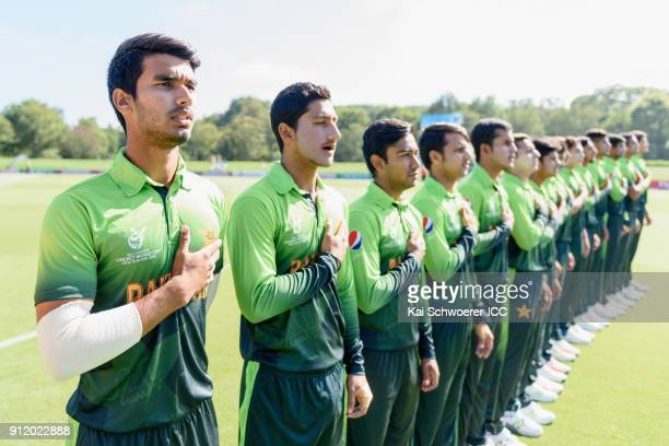 Captain Hasan Khan of Pakistan and his team mates line up for their national anthem prior to the ICC U19 Cricket World Cup Semi Final match between...