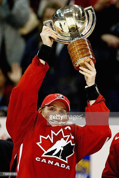 Captain Hayley Wickenheiser of Canada raises the trophy after the victory against the USA in the IIHF Women's World Championship Gold Medal game on...