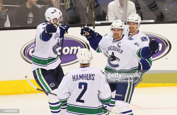Captain Henrik Sedin of the Vancouver Canucks celebrates his third period goal against the Los Angeles Kings with teammates Alexander Edler Dan...