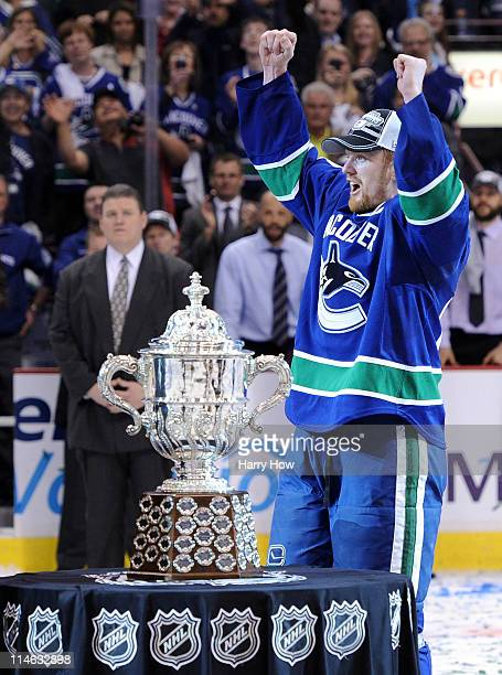 Captain Henrik Sedin of the Vancouver Canucks jubilates next to the Clarence Campbell Bowl after the Vancouver Canucks defeated the San Jose Sharks...