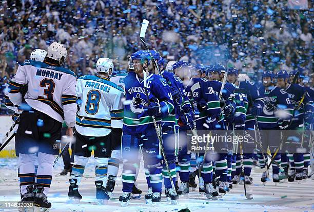 Captain Henrik Sedin of the Vancouver Canucks leads his team for the post game handshake with the San Jose Sharks after winning Game Five of the...