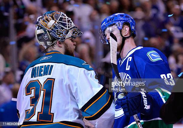 Captain Henrik Sedin of the Vancouver Canucks shakes hands with goaltender Antti Niemi of the San Jose Sharks after the Vancouver Canucks won Game...