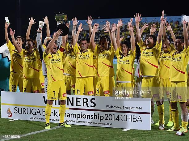 Captain Hidekazu Otani of Kashiwa Reysol lifts the trophy to celebrate winning the Suruga Bank Championships 2014 match between Kashiwa Reysol and...