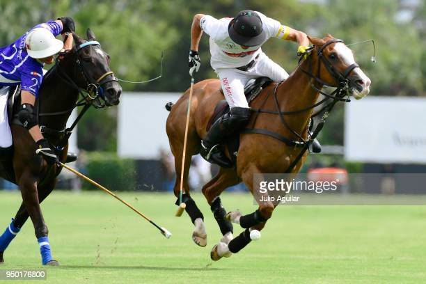 Captain Hilario Ulloa of The Daily Racing Form juggles the ball from Tommy Beresford of Valiente in the US Open Polo Championship April 22 2018 in...