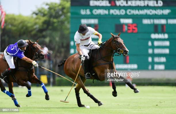 Captain Hilario Ulloa of The Daily Racing Form maintains control of the ball over Facundo Pieres of Valiente in the US Open Polo Championship April...