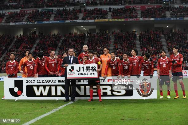 Captain Hisato Sato of Nagoya Grampus and JLeague Chairman Matsuru Murai pose for photographs after the JLeague J1 Promotion PlayOff Final between...