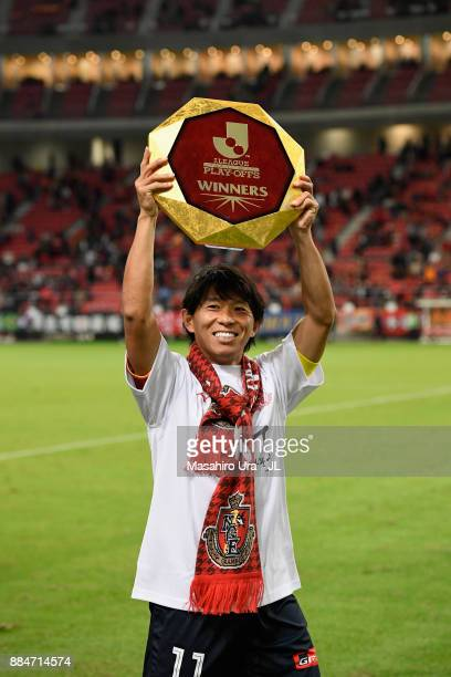Captain Hisato Sato of Nagoya Grampus applauds suppoorters as he celebrates the promotion to the J1 after the JLeague J1 Promotion PlayOff Final...