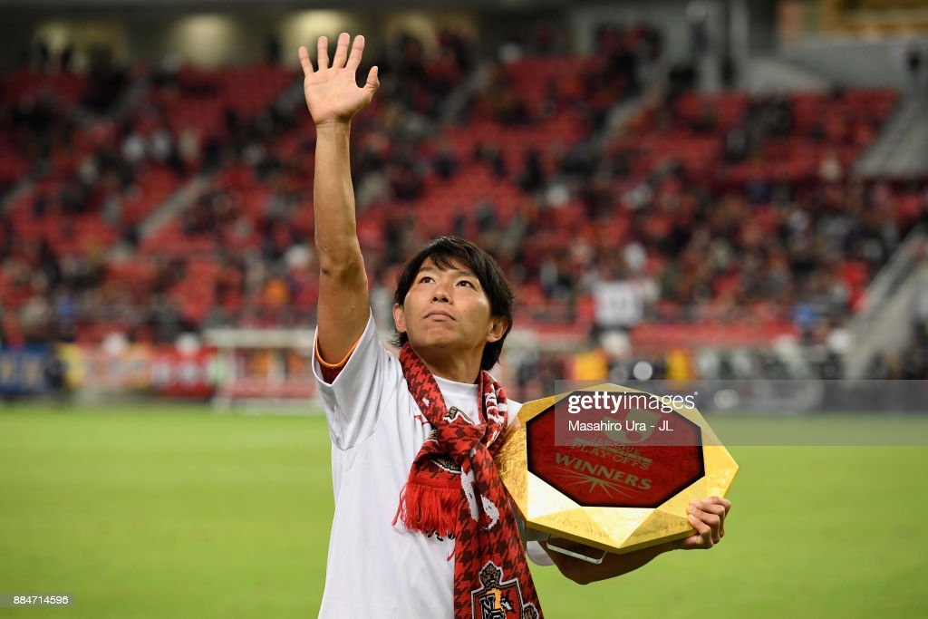 Captain Hisato Sato of Nagoya Grampus applauds suppoorters as he celebrates the promotion to the J1 after the J.League J1 Promotion Play-Off Final between Nagoya Grampus and Avispa Fukuoka at Toyota Stadium on December 3, 2017 in Toyota, Aichi, Japan.